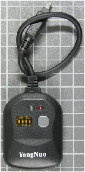 Non-compliant remote control for digital camera front view